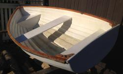 Sturdy 9 foot fiberglass dinghy with oars. Rows nicely.