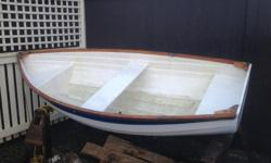 Sturdy 9 foot fiberglass dinghy with oars. Rows nicely. Located in Cobble Hill.