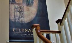 """Have a tall space to fill? Why not own this stunning 9-ft long lithograph from the British Museum's 2004 show """"Masterworks of the Ancient World"""". The banner displays an Egyptian mummy mask in high definition & resplendent in gold and jade tones. Looks"""