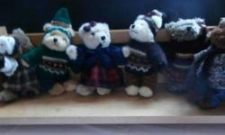 A Bevy of 6 Bears and their own bench; each one has its own little outfit; so cute any child will love them.