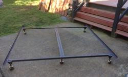 adjustable metal bed frame with castor wheels and center bar, will adjust from a double to a king ... $65.00