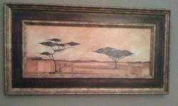 """This lovely wall painting measures 24"""" by 14"""". It is a picture of 2 African trees. Beautiful warm orange colours in the picture.This painting is great to hang on any wall in an office, home, bathroom, bedroom, etc. It is also framed. Great decor for any"""