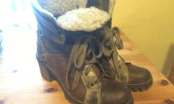 Leather stacked heel boots. Faux shearling lining on part of inside of boot Size 8 Very comfortable - great condition only worn a few times