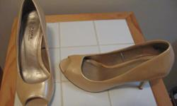 """size: 7 2"""" heel, peep toe color: yellow gold patent condition: like new"""
