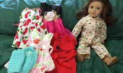 Used Good Condition American Girl Doll includes a few doll clothes.