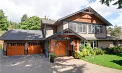 # Bath 7 Sq Ft 4224 # Bed 5 Quality custom built 2007 home with 5 beds and 7 baths over4000 sft. Just mins to Mt. Doug Beach. large privately set back driveway and enter the home . High end quality solid oak doors. The main level features an A large OPEN