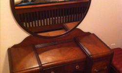 I have a Beautiful Late 1940's Antique Bedroom Dresser with Mirror and Stool. This item was restored by a high end Antique Craftsman years ago. It looks like it was Restored Yesterday. It comes with all it's original hardware. This unit is Drop Dead