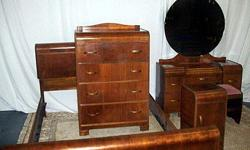 5-piece 1940's Beautiful All-Wood Bedroom Suite Suite is in storage Pictures very close to original suite Double size bed with brand new mattress Gorgeous mirrored matching dresser 4-drawer chest of drawers One end table with one drawer Dresser bench seat
