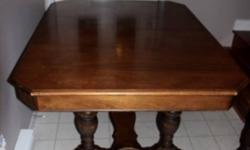 Walnut antique dining room set. Has table with gear-driven large leaf which folds from under table, 4 chairs & 1 captain chair, all with original leather seats intact. Buffet is 5ft long with lovely etched design- 2 large doors and 3 drawers. This ad was