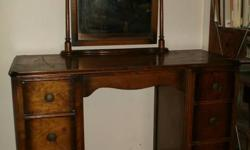 Beautiful little dresser in good condition, would ask much more but for small bit of veneer chipped off top right hand side (could be easily restored). The mirror tilts, suspended on 2 posts which have been hand-turned on a lathe, must be 50-70 years old.
