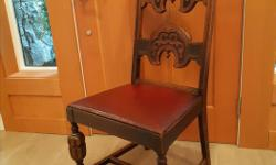 Unique Oak Antique Chair in excellent shape, still has original leather on seat. Use as is.. or recover. Carved oak details, leather is in good condition would be great as an accent chair. Located In MILL BAY