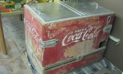Antique Coca-cola cooler. Genuine colector's item. In need of TLC. A perfect do-it-yourself project. Estimated year in the 1950's.