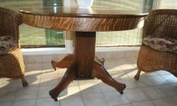I HAVE A LOVELY OAK PEDESTAL TABLE FOR SALE. (NO LEAVES)  SEATS 4-6. REFINISHED. MOVING MUST GO