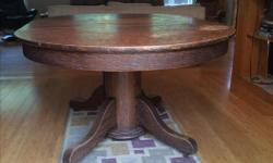 This table is quite old, it has wooden wheels. It does need to be refinished. Pictured with and without leaves. Seats 6 with leaves.