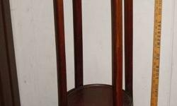from estate...first time on market British Antique Roadshow artifact. Pot Stand. made of hardwood and inlay imbedded in the round top and on each leg plus on outside edge of top. not common to find = rare.  available and possible to pick-up or can arrange