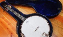 vintage Slingerland 4 string tenor banjo from the 30's or 40's with original case and even some old replacement strings in package. The over-all condition is pretty good but it is currently not 100% playable. One or two of the original ivory tuner heads