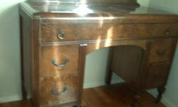 Antique dark wood vanity / dresser for sale. One large top drawer with inset jewellery compartment, and four smaller drawers. The dresser has the original hardware and wheels. A little water damage, but a beautiful antique piece of furniture.
