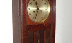 Antique wall Clock  Fully working. Oak Case, Pendulum clock with chime. excellent condition.