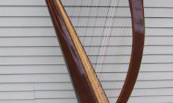 Aoyama 34-string Folk Harp with cloth cover, 2 sets of removable legs, tuning wrench Model 130 B - Serial #610804 - Excellent condition Full set of brass levers with blue and red markers Round-back soundbox, spruce soundboard with lamination of maple and