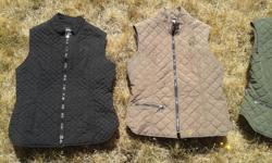 Arista quilted schooling vests in excellent condition. $30 each or $50 for 2 or $90 for 4. Black is a small, brown, green and grey colours are medium.
