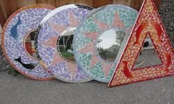 Decrative art pieces.....3 round and 1 triangle $1 each some mirror broken, face of girl 5.....call Julie 250-707-3070