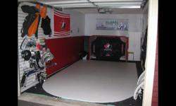 This is a budding goalie's dream! Be your hockey child's hero. This junior size artificial ice can be skated on with REAL skates. Your goalie can practice stops, gliding, stopping shots... The image of the assembled ice is from our single car garage;