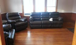 Ashley Brand Leather double recliner sofa - in excellent condition. Full size. Comes apart for transport. Dark brown in colour.