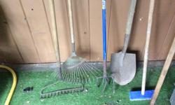 An assortment of garden rakes and shovels, and a few more that are not in the picture. 250-722-2368