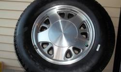 4 CHEVY ASTRO ALLOY OEM RIMS MOUNTED WITH Michelin P215/75R15 130,000 KM WARRANTY RATED!! 90,000 KM LEFT SPARE TIRE (FULL SIZE ALLOY WITH TIRE) BALANCED AND READY TO INSTALL!!! EXCELLENT CONDITION!!! FITS ALL1991,92,93,94,95,96,97,98,1999,2000 (Wrecker
