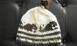 Get ready for the cold winter! This authentic Cowichan Knit Toque will keep you nice and warm. Cream & brown Whale design new never used! A great gift to yourself or someone special