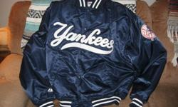 Just in time for Christmas another Yankees jacket that is now too large for me to wear and I don't think they are available at this time even in New York where this one comes from. This nylon dugout jacket is in NEW condition as I have only worn it twice
