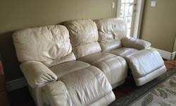 Cream colored auto recline sofa. Super comfortable, family room sofa so showing some wear and tear , 7ft long Was $1600 New, moving, so great deal @$275