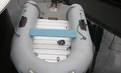 Avon Inflatable  R2.85 in good condition, comes with pump and wooden collapsible oars.