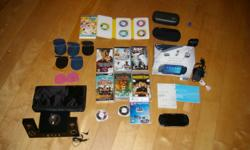 Just in Time for Christmas PSP 1000 SYSTEM AND ACCESSORIES -PSP 1000 Console with Original Box and Manal -Mad Cat Hard Case -PSP soft Travel Case -Home and Car Charger -2 gb and 8 gb Memory Card with Memory Stick Duo Adapter - Several UMD Carry Cases -