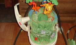 Fisher Price Baby Swing GREAT used condition Plug in or battery operated Seat is movable, various speeds, music & mobile   $40.00 OBO
