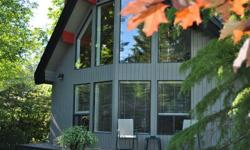 # Bath 2 Sq Ft 1174 MLS 405444 # Bed 3 Your retreat from the modern world! Located in desirable Craigdarroch Estates on just under half an acre within walking distance to beaches, trails and easy highway access. This South facing, 1351sqft, A-frame style