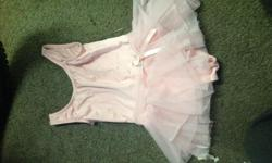 Excellent condition. Lightly used. Outgrew. Not sure size. Fit our girl when she was 5/6 years old. Pretty in pink!