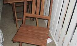 """Made of Bamboo. The table measures 23 1/2"""" X 23 1/2"""". Very sturdy and in excellent near new condition - stored in the winter all winter and kept oiled. (I have fairly full tin of Lemon Oil left over to be included). The chairs and table collapse as"""