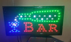 "Plastic wrapped (see picture) Beautiful LED Sign for a Man Cave Plug in to 120 volt socket Moving LED lights pour into glass Wood Framed, still in plastic wrap Measures 10"" x 19"""