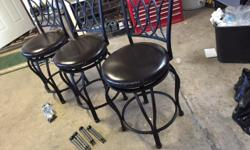 Three counter height bar stools c/w leg extensions for bar height. hardly used, in good condition. $75.00 takes all three.Campbell River area.