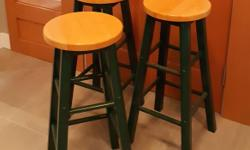 "Three bar height stools, well built and solid. Dark Green base light stained wood top.. in great condition. no wobbles Use them as they are or paint them up...$75 for all three or $25 each These are bar height- not counter height 29.5"" high LOCATED IN"