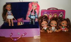 Various dolls - all in excellent condition! Also included are the storage tins for accessories & clothing, etc...