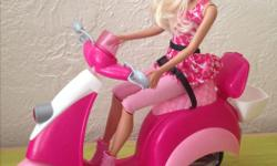 Rarely used Barbie doll with scooter. Helmet included.