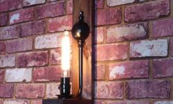 BASEBALL EDISON LAMP NEW, made by a local lampmaker. This uniquely crafted lamp is definitely one-of-a-kind. Comes with an iron sconce mounted on salvaged pallet wood, and two softballs painted in chalkboard paint. You can write any message you wish on