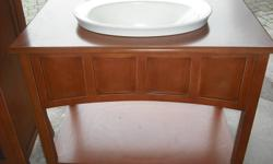 Never used, open design vanity with matching towel/storage cabinet; rusty brown in colour, very elegant for a new bathroom renovation. Regular price was $5,200.