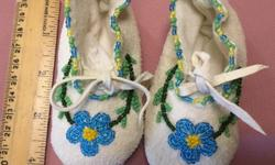Beautifully beaded baby slippers which I believe are native beaded on deerskin or suede. In excellent condition