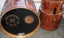 Up for sale is one of the warmest sounding drum-set's I've ever played. I'm the original owner and the kit was $6400 new. 2002 Bearing Edge Custom Drums, Waterfall bubinga exotic wood, with matching wood hoops, All brass hardware, New remo Ambassadors on