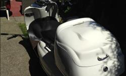 50cc scooter. Very European looking. Has windshield. Low mileage. She is a head turner and in perfect condition.