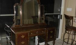 Dark walnut antique dresser with mirror, early 1900's. 5 Drawers, on wheels. Professionally redone about 18 years ago, paid $1000. Offers?