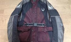 AS NEW. Black/Burgandy, zip out lining and armour Size Medium